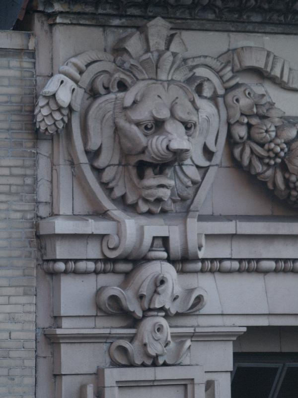 New york city ny 320 fifth avenue lion decoration at top of